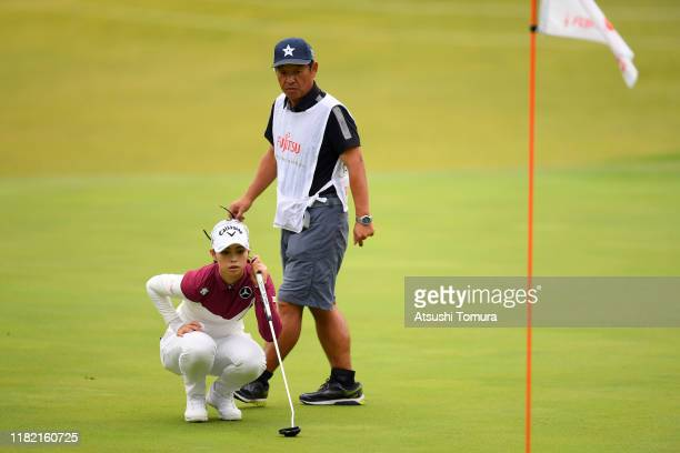 Asuka Kashiwabara of Japan lines up a putt on the 1st green during the final round of Fujitsu Ladies at Tokyu Seven Hundred Club on October 20 2019...
