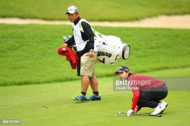 Asuka Kashiwabara of Japan looks on during the first round of Stanley Ladies Golf Tournament at the Tomei Country Club on October 6, 2017 in Susono,...
