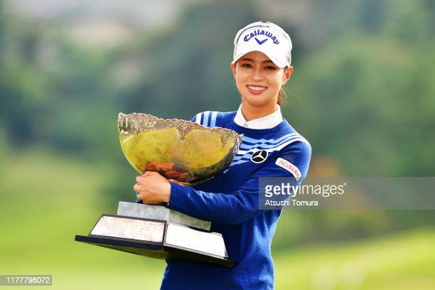 Asuka Kashiwabara of Japan poses with the trophy after winning the tournament following the final round of the Miyagi TV Cup Dunlop Women's Open at...
