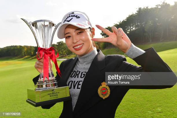 Asuka Kashiwabara of Japan poses with the trophy after winning the tournament following the final round of the Nobuta Group Masters GC Ladies at...