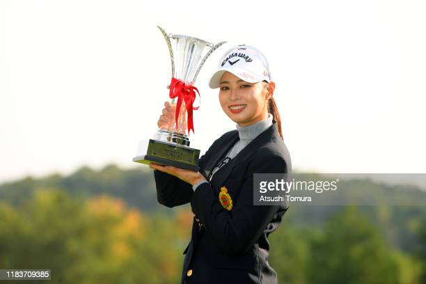 Asuka Kashiwabara of Japan poses with the trophy after winning the tournament at the award ceremony following the final round of the Nobuta Group...