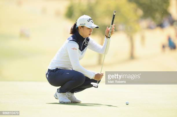 Asuka Kashiwabara of Japan prepares to putt on the first green during the first round of the AXA Ladies Golf Tournament In Miyazaki at the UMK...