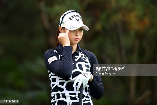 Asuka Kashiwabara of Japan reacts after her tee shot on the 4th hole during the final round of the LPGA Tour Championship Ricoh Cup at Miyazaki...