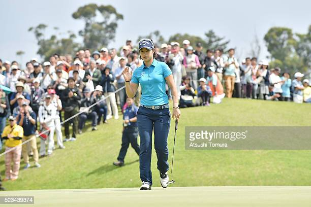 Asuka Kashiwabara of Japan reacts after making her biedie putt on the 7th hole during the second round of the Fujisankei Ladies Classic at the Kawana...