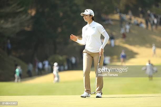 Asuka Kashiwabara of Japan reacts after making her birdie putt on the 16th hole during the T-Point Ladies Golf Tournament at the Wakagi Golf Club on...
