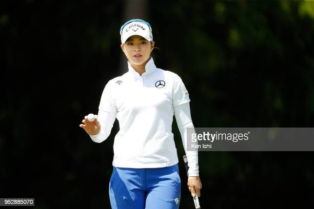 Asuka Kashiwabara of Japan reacts the 14th green during the final round of the CyberAgent Ladies Golf Tournament at Grand fields Country Club on...