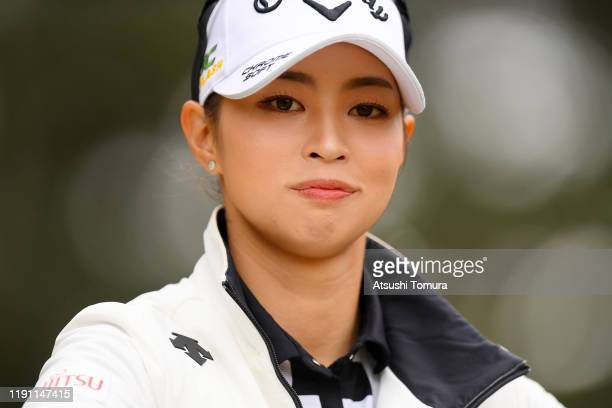Asuka Kashiwabara of Japan smiles after her tee shot on the 2nd hole during the final round of the LPGA Tour Championship Ricoh Cup at Miyazaki...