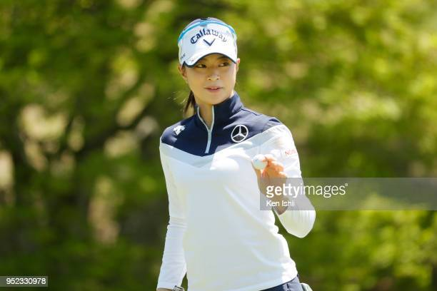 Asuka Kashiwabara of Japan waves to the gallery on the 4th green during the second round of the CyberAgent Ladies Golf Tournament at Grand fields...