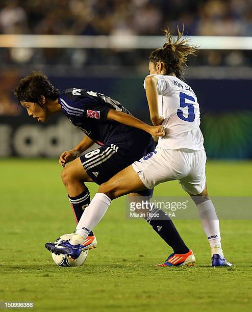 Asuka Nishikawa of Japan and Jihye Kim of Korea Republic battle for the ball during the FIFA U20 Women's World Cup Japan 2012 Quarter Final match...