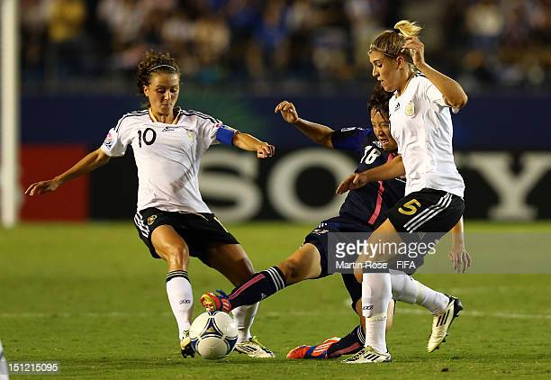 Asuka Nishikawa of Japan and Ramona Petzelberger and Luisa Wensing of Germany battle for the ball during the FIFA U20 Women's World Cup Japan 2012...