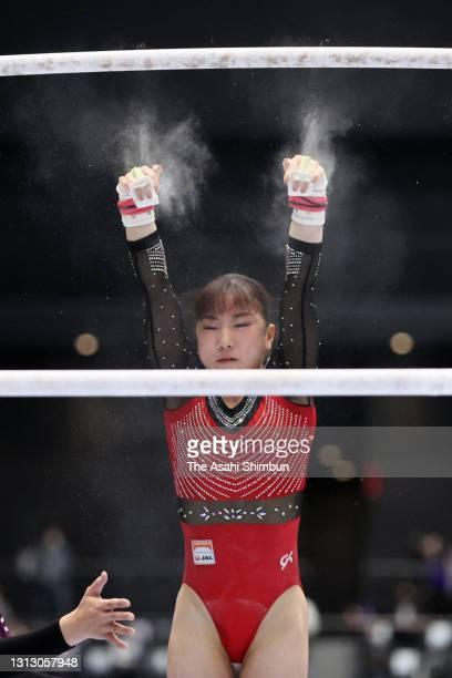 Asuka Teramoto falls while competing in the Uneven Bars competes in the yyy during the women's final on day three of the 75th All Japan Artistic...