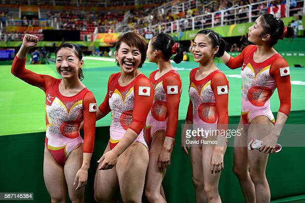 Asuka Teramoto Mai Murakami Sae Miyakawa Aiko Sugihara and Yuki Uchiyama of Japan pose for photographs after the Women's qualification for Artistic...