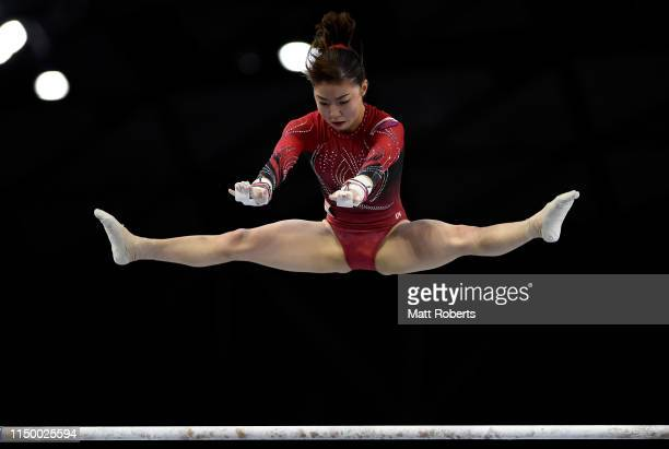 Asuka Teramoto of Japan competes on the Uneven Bars during day one of the Artistic Gymnastics NHK Trophy at Musashino Forest Sport Plaza on May 18...