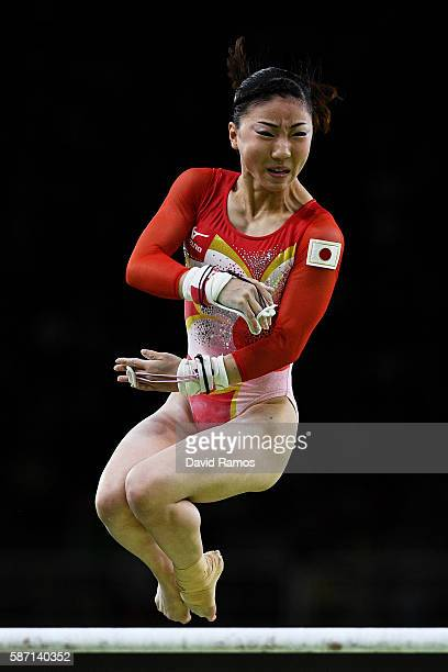 Asuka Teramoto of Japan competes on the uneven bars during Women's qualification for Artistic Gymnastics on Day 2 of the Rio 2016 Olympic Games at...