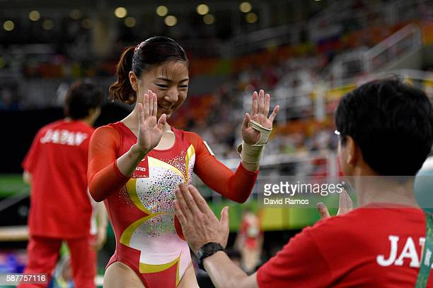 Asuka Teramoto of Japan high fives with her coach after competing on the vault during the Artistic Gymnastics Women's Team Final on Day 4 of the Rio...