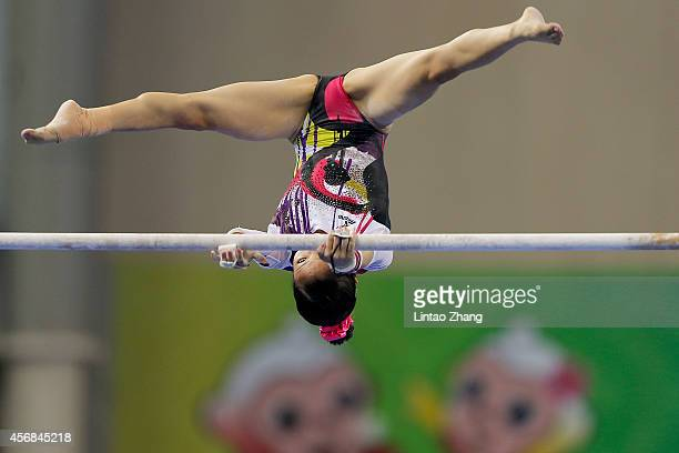 Asuka Teramoto of Japan performs on the uneven bars during the Women's Team Final on day two of the 45th Artistic Gymnastics World Championships at...