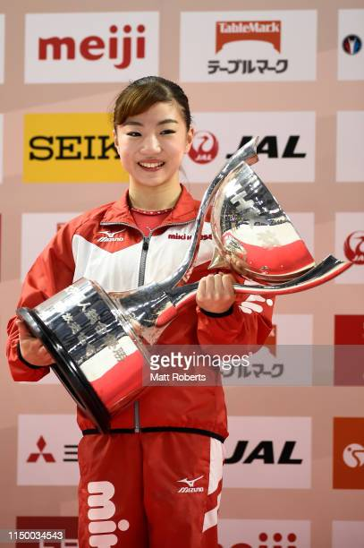 Asuka Teramoto of Japan poses with the trophy on day one of the Artistic Gymnastics NHK Trophy at Musashino Forest Sport Plaza on May 18 2019 in...