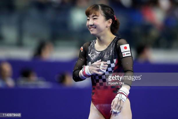 Asuka Teramoto of Japan reacts after competing in the Women's Uneven Bars during the FIG Artistic Gymnastics AllAround World Cup Tokyo at Musashino...