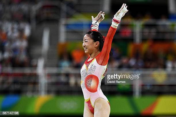 Asuka Teramoto of Japan reacts after competing on the uneven bars during Women's qualification for Artistic Gymnastics on Day 2 of the Rio 2016...