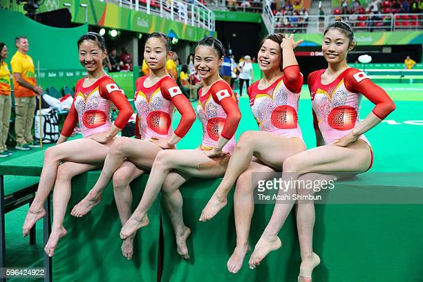 Asuka Teramoto Sae Miyakawa Aiko Sugihara Mai Murakami and Yuki Uchiyama of Japan celebrate after the Women's Team qualification of the Artistic...