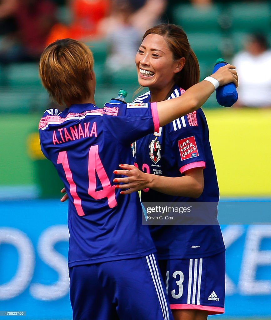 Asuna Tanaka #14 and Rumi Utsugi #13 of Japan celebrate their 1-0 win over Australia in the FIFA Women's World Cup Canada 2015 Quarter Final match between Australia and Japan at Commonwealth Stadium on June 27, 2015 in Edmonton, Canada.