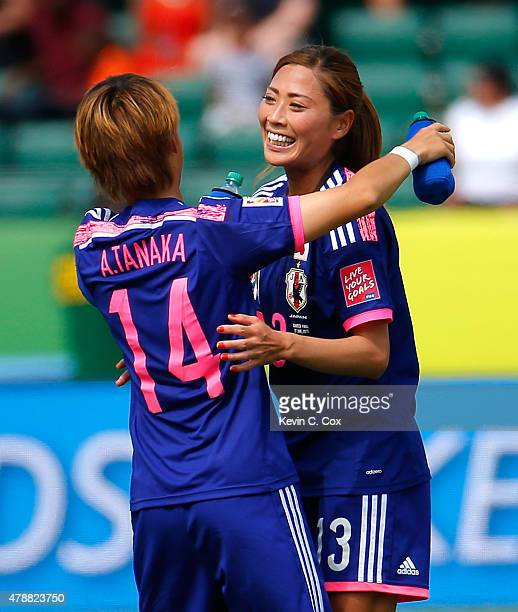 Asuna Tanaka and Rumi Utsugi of Japan celebrate their 10 win over Australia in the FIFA Women's World Cup Canada 2015 Quarter Final match between...