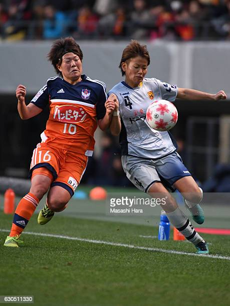 Asuna Tanaka of INAC Kobe Leonessa and Miyuki Takahashi of Albirex Nigata Ladies compete for the ball during the 38th Empress's Cup Final between...