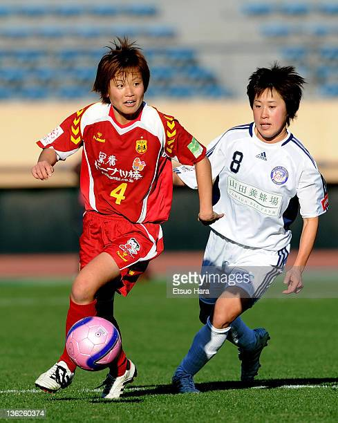 Asuna Tanaka of INAC Kobe Leonessa and Saori Arimachi of Okayama Yunogo Belle compete for the ball during the All Japan Women's Soccer Championship...