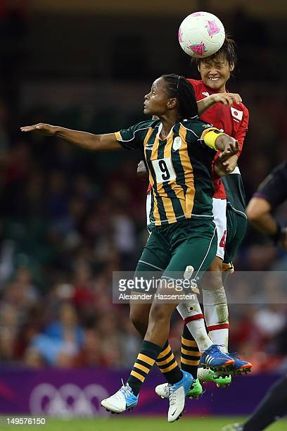 Asuna Tanaka of Japan battles for the ball with Amanda Dlamini of South Africa during the Women's Football first round Group F Match between Japan...