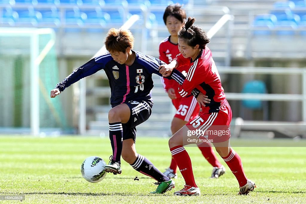 Asuna Tanaka of Japan challenges Lei Jiahui of China during the Algarve Cup 2013 fifth place match at the Estadio Algarve on March 13, 2013 in Faro, Portugal.