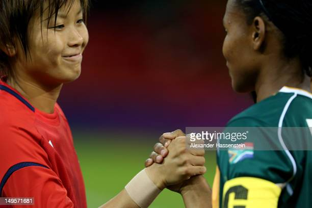 Asuna Tanaka of Japan shake hands with Amanda Dlamini of South Africa prior the Women's Football first round Group F Match between Japan and South...