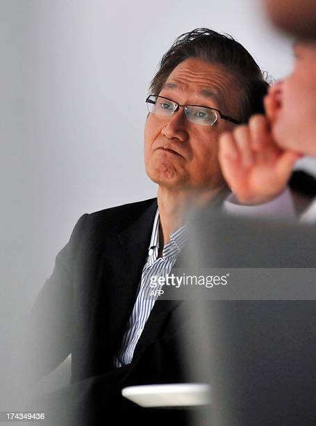 Asus CEO Jerry Shen looks on while Google executive Mario Queiroz Vice President of Product Management at Google announces the new Google Chromecast...