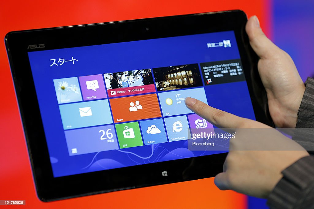 Asustek Computer Inc.'s ASUS Vivo Tab RT TF600T tablet computer, running Microsoft Corp.'s Windows RT operating system, is displayed during a launch event for the company's Windows 8 operating system in Tokyo, Japan, on Friday, Oct. 26, 2012. Microsoft introduced the biggest overhaul of its flagship Windows software in two decades, reflecting the rising stakes in its competition with Apple Inc. and Google Inc. for the loyalty of customers who are shunning personal computers and flocking to mobile devices. Photographer: Kiyoshi Ota/Bloomberg via Getty Images