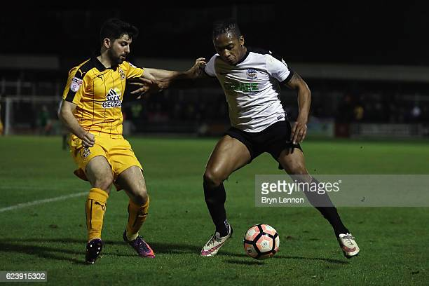 Aswad Thomas of Dover Athletic avoids Pietro Mingoia of Cambridge United during the Emirates FA Cup First Round Replay match between Dover Athletic...