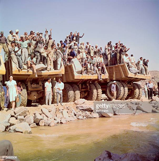 Aswan, where last gap in upstream coffer dam was closed is shown with last preparations, dam entrance and exit, and show of workers.