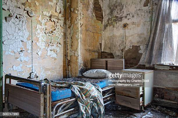 asylum bed - rotten com stock pictures, royalty-free photos & images