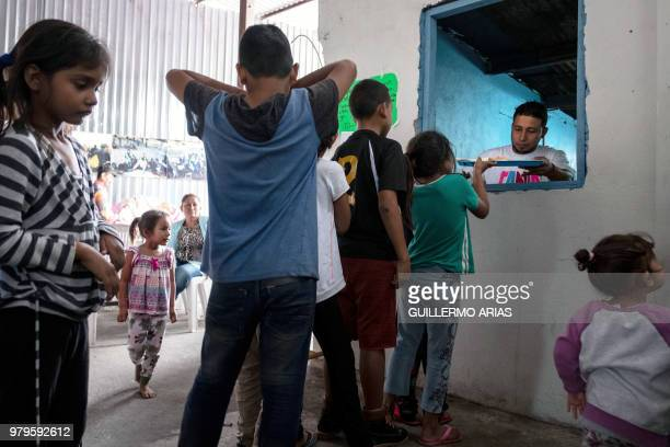 Asylum seeker children from Mexico and Central America line up for their breakfast at Juventud 2000 migrant shelter in Tijuana on June 20 2018 US...
