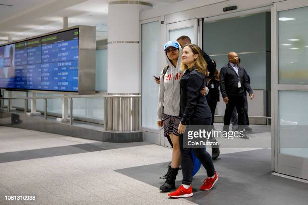 Asylum Seeker Rahaf Mohammed alQunun is lead out to be introduced to the media at Toronto Pearson International Airport by Canadian minister of...
