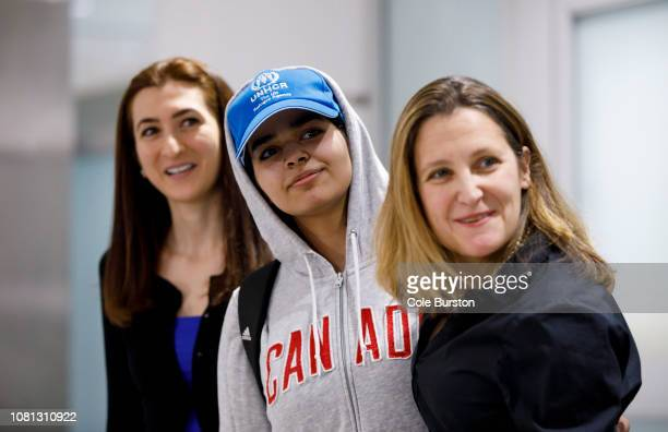 Asylum Seeker Rahaf Mohammed alQunun smiles as she is introduced to the media at Toronto Pearson International Airport alongside Canadian minister of...