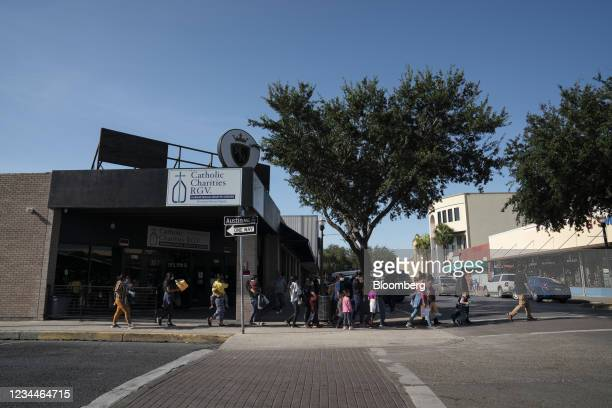 Asylum seekers are lead towards a bus station in McAllen, Texas, U.S., on Wednesday, Aug. 4, 2021. A federal judge temporarily blocked Texas state...