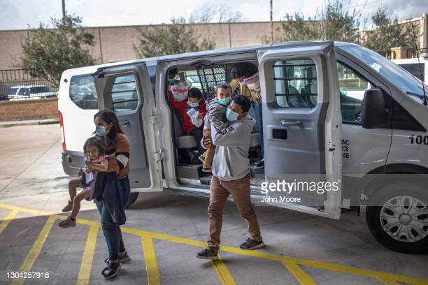 Asylum seekers are released by the U.S. Border Patrol at a bus station on February 26, 2021 in Brownsville, Texas. U.S. Immigration authorities are...