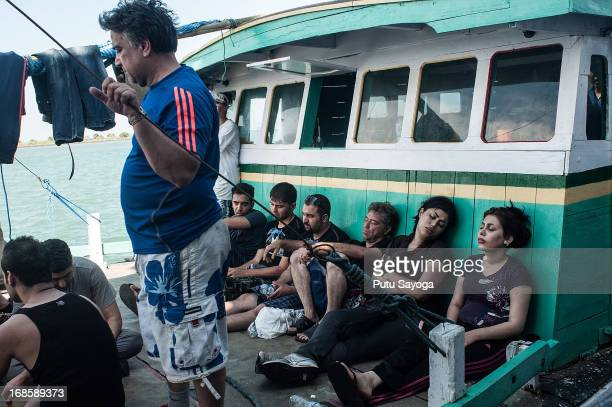 Asylum seekers are seen resting on a boat on May 12 2013 in Bali Indonesia Indonesian police have intercepted an asylum seeker boat harboured in Bali...
