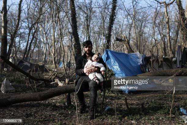 Asylum seekers, arrived in Edirne mostly from Istanbul and many other Turkish cities, are seen waiting at woodland near buffer zone located between...