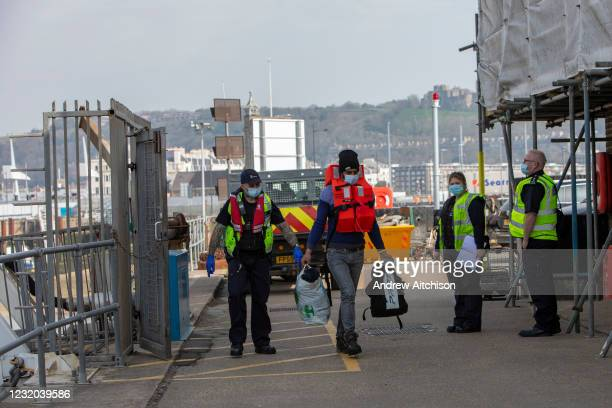 Asylum seekers arriving into Dover accompanied by Boarder Force officers after being on board a Boarder Force RIB boat, they were rescued in the...