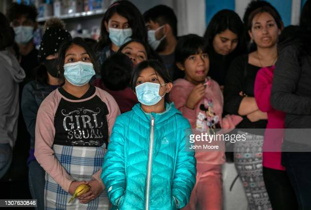 Asylum seekers attend a meeting at an immigrant shelter on March 16, 2021 in Ciudad Juarez, Mexico. A surge of immigrant families and as many as...