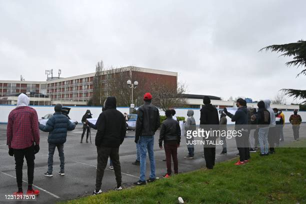 Asylum seekers being housed at the Crowne Plaza hotel as they wait for their asylum claims to be processed, protest their living conditions and the...