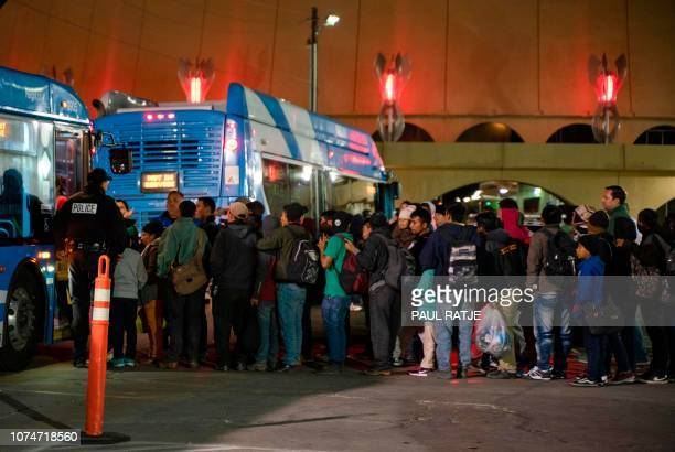 Asylum seekers board a bus stop after they were dropped off by Immigration and Customs Enforcement officials earlier at the Greyhound bus station in...