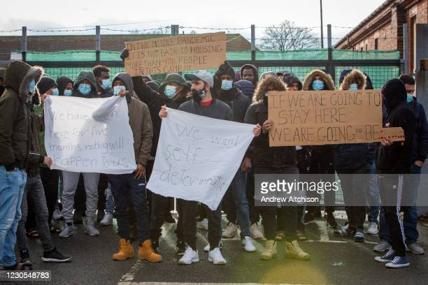 Asylum seekers currently held inside Napier Barracks staged a peaceful protest outside the entrance to the barracks with banners and signs to...