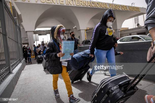 Asylum seekers enter into the United States from Mexico on March 16, 2021 in Ciudad Juarez, Mexico. Some 50 asylum seekers were officially allowed to...