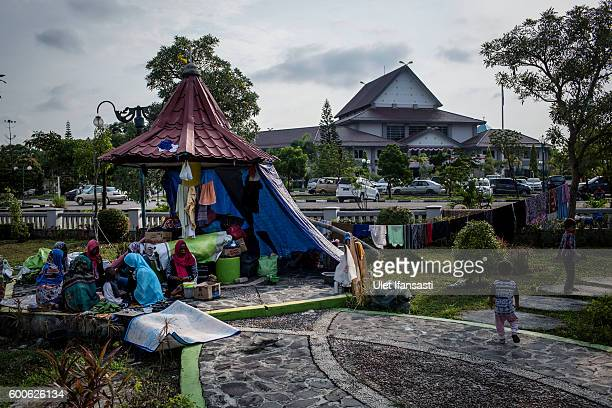Asylum seekers from Sudan are seen in their temporary tent in the city park next to the regional parliament building for the city of Batam on...